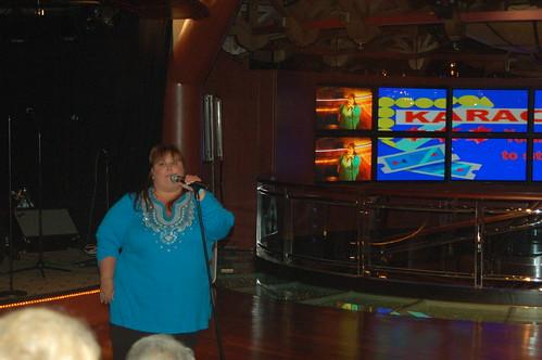 Singing Karaoke by you.