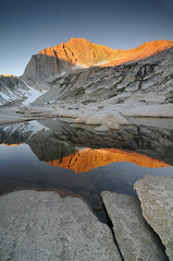 Sierra Glow (Michael Bollino) Tags: california morning mountain snow reflection nature water rock sunrise landscape pond sierra backpacking yosemite sierranevada tarn alpenglow mounatins goldstaraward
