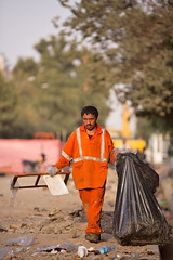 Cleaning up (damonlynch) Tags: street people man persian iran drain worker iranian tehran cleaner streetcleaner dustman garbagecollector
