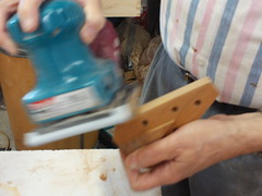 Then we rounded the outer edges of the peghead with a hand sander.
