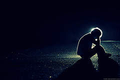 fetal (e.cera) Tags: shadow man silhouette night canon pavement halo stroke 10d fetus gravel fetal