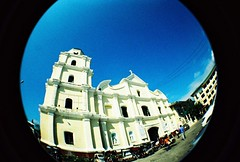 alaminos cathedral in fisheye view (darkcanopy) Tags: blue summer color colour film tourism colors analog lomo xpro lomography crossprocessed phil kodak crossprocess philippines wideangle slide fisheye analogue ph elitechrome analogphotography lomograph eb pangasinan hundredislands lsi filmphotography lomofisheye fisheye2 xprod lomolove lomofisheye2 170degrees 170