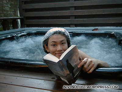 Rachel enjoying the jacuzzi while reading