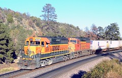 BNSF GP40 3016 and GP60M 110 lead a westbound intermodal train, east of Flagstaff, Coconino County, Arizona, September, 2003 (Ivan S. Abrams) Tags: arizona electric diesel ivan trains getty freighttrains abrams ge railways locomotives gettyimages railroads generalelectric smrgsbord tucsonarizona eriepennsylvania 12608 diesellocomotives onlythebestare ivansabrams trainplanepro pimacountyarizona safyan arizonabar arizonaphotographers ivanabrams cochisecountyarizona getransportationsystems gettyimagesandtheflickrcollection copyrightivansabramsallrightsreservedunauthorizeduseofthisimageisprohibited tucson3985gmailcom ivansafyanabrams arizonalawyers statebarofarizona californialawyers copyrightivansafyanabrams2009allrightsreservedunauthorizeduseprohibitedbylawpropertyofivansafyanabrams unauthorizeduseconstitutestheft thisphotographwasmadebyivansafyanabramswhoretainsallrightstheretoc2009ivansafyanabrams abramsandmcdanielinternationallawandeconomicdiplomacy ivansabramsarizonaattorney ivansabramsbauniversityofpittsburghjduniversityofpittsburghllmuniversityofarizonainternationallawyer