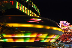 Carnival: Motion and Stillness (StGrundy) Tags: longexposure carnival atlanta red summer usa motion black green colors yellow night dark georgia lights lowlight nikon force nightshot south roswell blurred southern spinning rides rotating amusements gravitron gettyimages rotate centrifugal d80 colorphotoaward peachtreerides artistsoftheyear platinumheartaward