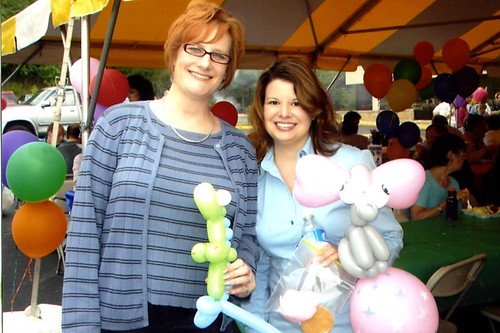 Hot chicks with balloon animals.