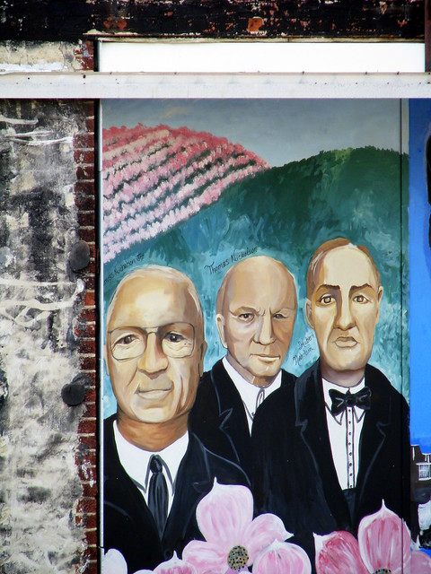 3 important men on a mural