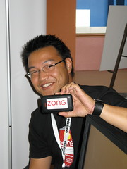 VGsummit - Sonny showing off branded iPhone (davidmarcus) Tags: zong vgsummit2008
