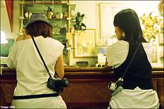 Camera ladies! (Twiggy Tu) Tags: portrait film taiwan coffeeshop taipei nia sigrid 2008 laboheme coffeetime contaxrx carlzeissplanart50mmf14 shehercamera