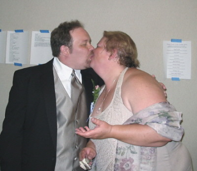 Two fat guys kissing