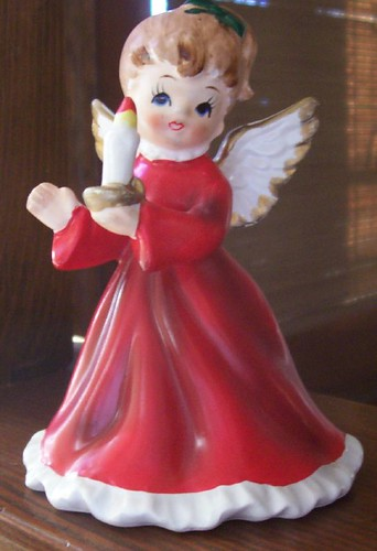 Angel in red dress with candle