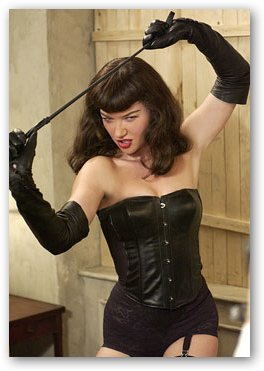 Bettie Page Holding Whip