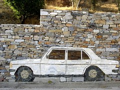 WALL GRAFITI by stones (dimitra_milaiou) Tags: road door 2 two white art car wheel stone architecture painting island greek grey one 1 design living beige europe paint day village sony wheels ikaria aegean hellas humour greece dimitra hellenic dscp93a   aigaio   milaiou