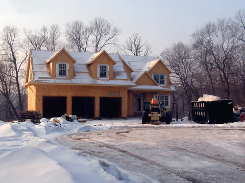 A 3 Car Garage, with house attached.