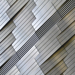 Building Detail (Carl Carl) Tags: abstract detail building lines metal square shiny pattern jazz diagonal plates rhythm cladding 500x500