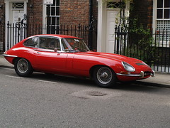 Jaguar E Type 002 (FrMark) Tags: street door city uk red england house london cars home sports car cat town 60s automobile britain style icon front e gb jag british jaguar railings sixties xke etype xk jaguaretype smithsquare steamlined