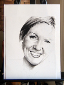 In progress photo of carbon pencil drawing entitled Ashley.