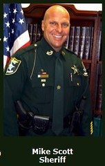 A racist sheriff. Mike Scott