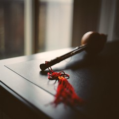 Melody Behind the Red Tassel (Inside_man) Tags: stilllife slr 120 6x6 film colors mediumformat colorful bokeh traditional bamboo gourd musicalinstrument lightandshadow hulusi bronicas2 portranc zenzabronicas2 mycolletion melodybehindtheredtassel