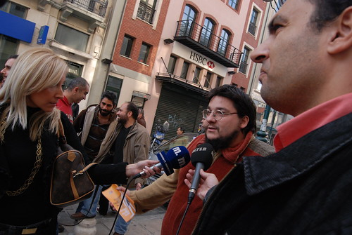 Syriza party members being interviewed by the press