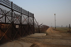The border fence Indo Pak (Samjautha express) (Boudhi Tree) Tags: pakistan india border international conflict roads punjab boundaries borders frontier indopakistan patrolling indiapakistan attari