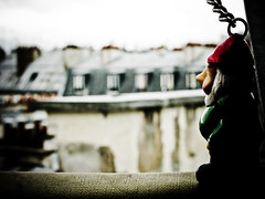 Gnome looking out over the Roof Tops of Paris, France (Marty Portier) Tags: roof italy paris home gnome away amelie tops poulain