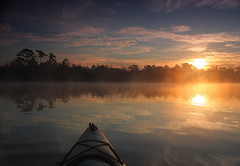 kayaking in the fog at sunrise (Marc Crumpler (Ilikethenight)) Tags: morning usa water fog clouds sunrise canon reflections bravo kayak lakes southcarolina goosecreek outstandingshots tamron1750 40d aplusphoto canon40d flickrclassique