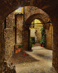 Passage in the hilltop village of Monterchi, Italy (Anguskirk) Tags: old pink italy streets colour building rain yellow architecture pretty italia village terracotta passages tuscany raining archways quaint picturesque 2009 hilltop alleys topaz arezzo monterchi pageandmoy pagemoy