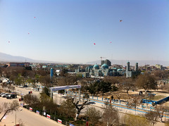 Toy Parachutes Landing on Blue Mosque Grounds
