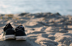 Summer. (Daniel.Lam) Tags: sea summer blur beach water field out photography 50mm blurry nikon focus shoes dof bokeh daniel 14 blurred sneakers converse alki shallow depth lam oof d40 daniellam of daniellamphotography