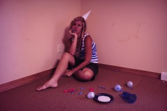 Day 135:  Party Pooper. (lindseyy.) Tags: party selfportrait me hat balloons necklace stripes bored ground dirty sp tired icecream haha walls mardigras melted tones pinkish bruises partypooper ehh 365days foreffect orisitaffect dontknowwherethosecamefrom