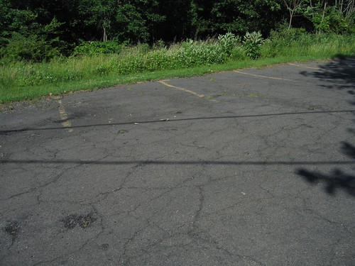 Faded cracked parking spaces