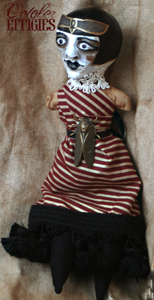 A 1920's Egyptian revival Doll