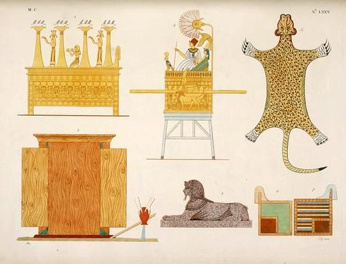 16-Una verdadera cama, un pequeño trono con la estatuilla de oro del rey, una piel  de tigré, un palanquin; una pequeña esfinge, dos tronos