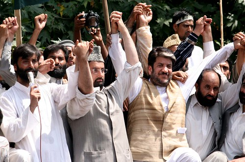 Kashmiri leaders Yasin Malik, Mirwaiz Umar Farooq and Syed Shabir Shah addressing Kashmiri protestors in Srinagar on Aug 18, 2008.