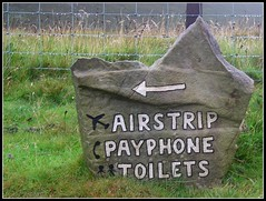 Whatever you need, it's to the left (katrin glaesmann) Tags: holiday stone scotland payphone signpost 2008 toilets shetland airstrip foula