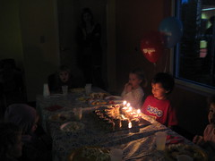 Ezra blowing out candles