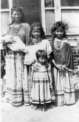 Ruby Jumper Billie holding her infant Billie L. Cypress (State Library and Archives of Florida) Tags: family girls children infant florida seminoles nativeamerican dresses barefoot everglades womensday statelibraryandarchivesofflorida