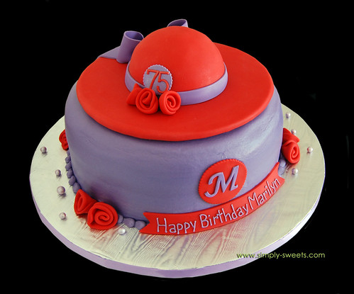 75th birthday cake with red hat