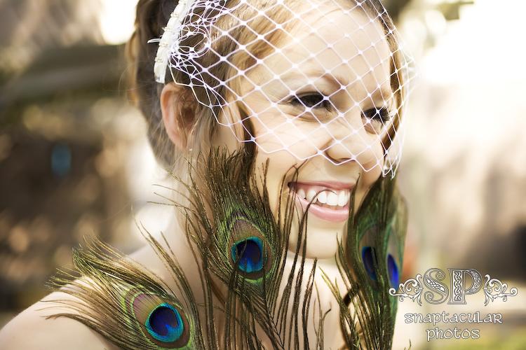 porsche's backyard bridal session spring, texas peacock feathers and birdcage veil
