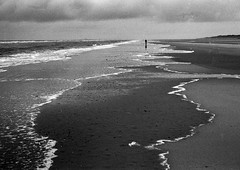 Juist - North See - the beach (redfalo) Tags: winter sea vacation beach clouds strand germany island sand scans walk north juist nordsee wetter spaziergang leicam6 fujiacross100 schwarzweis strandspaziergang schlechtes