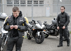 Checking the phone (Petra Cross) Tags: cellphone biker leathers bubli motorcyclis zaskodnik