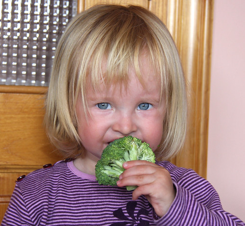Nora eating broccoli