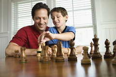 Sports & Recreation (iconicphotoservices) Tags: game color horizontal child play unitedstates chess northcarolina move indoors parent photograph learning leisure recreation boardgame teach twopeople learn strategy baldheadisland concentrate caucasian headandshoulders midadultman 1012years preteenboy 4045years sportsandrecreation