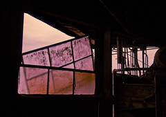 pressing (helveticaneue) Tags: abandoned philadelphia window silhouette march pier rust interior oxidation fertilizer pane 2008 trespassing ironore conrail southphilly ironorepier orepier pier122