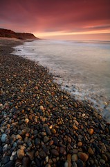 Wave-Polished Rocks (Nick Carver Photography) Tags: ocean california ca travel winter sunset sea usa cloud beach nature water rock vertical clouds landscape outdoors coast landscapes us rocks surf waves pacific tide nick wave pebbles pebble carver southerncalifornia tides sanonofre sandiegocounty nickcarver sanonofrestatebeach ncpfineartprint