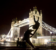 Tower Bridge and Girl with Dolphin Statue, London. (Theresa Elvin) Tags: england london night towerbridge golddragon mywinners abigfave frhwofavs goldstaraward 100commentgroup bhba girlwithdolphinstatue