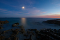 attraction of moon reflection (H o g n e) Tags: ocean longexposure blue sunset sea summer cloud moon seascape motion color colour reflection beach water rock stone night clouds dark landscape evening coast carved colorful mediterranean purple dusk horizon smooth shoreline violet erosion explore pebble shore silence pebblebeach moonlight colourful geology adriatic rockformations carvedstone carvedrock smoothwater smoothsurface smoothstone bildekritikk smoothrock silkwater