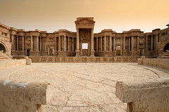 The Roman Theatre, Palmyra. ( Libyan Soup) Tags: city morning abandoned stone sunrise geotagged dawn early ruins theater alone roman empty stage columns nobody nopeople unescoworldheritagesite rows arabia syria arabian seating pillars destroyed deserted palmyra syrian  antiquity syrie romantheatre palmyre tadmor  tadmur syrianarabrepublic sriyah sriy  brideofthedesert palmyrene libyansoup scenaefrons geo:lat=34550486 geo:lon=38268750