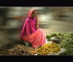 shy (lorytravelforever) Tags: street travel india fruits photoshop 50mm ginger nikon women bravo market documentary shy exotic motionblur delivery okra hindu sari viaggio s
